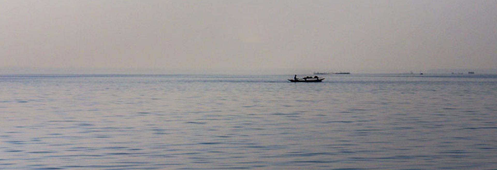 boat cruising along the beach