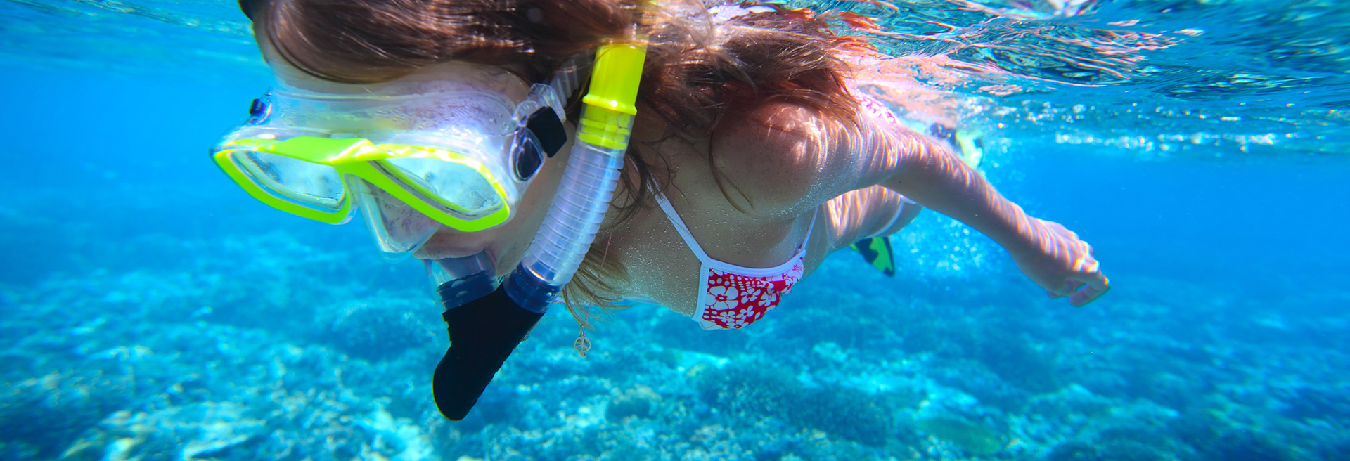 girl going snorkelling