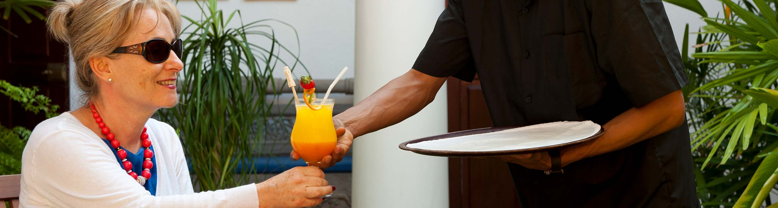 waiter serving a juice