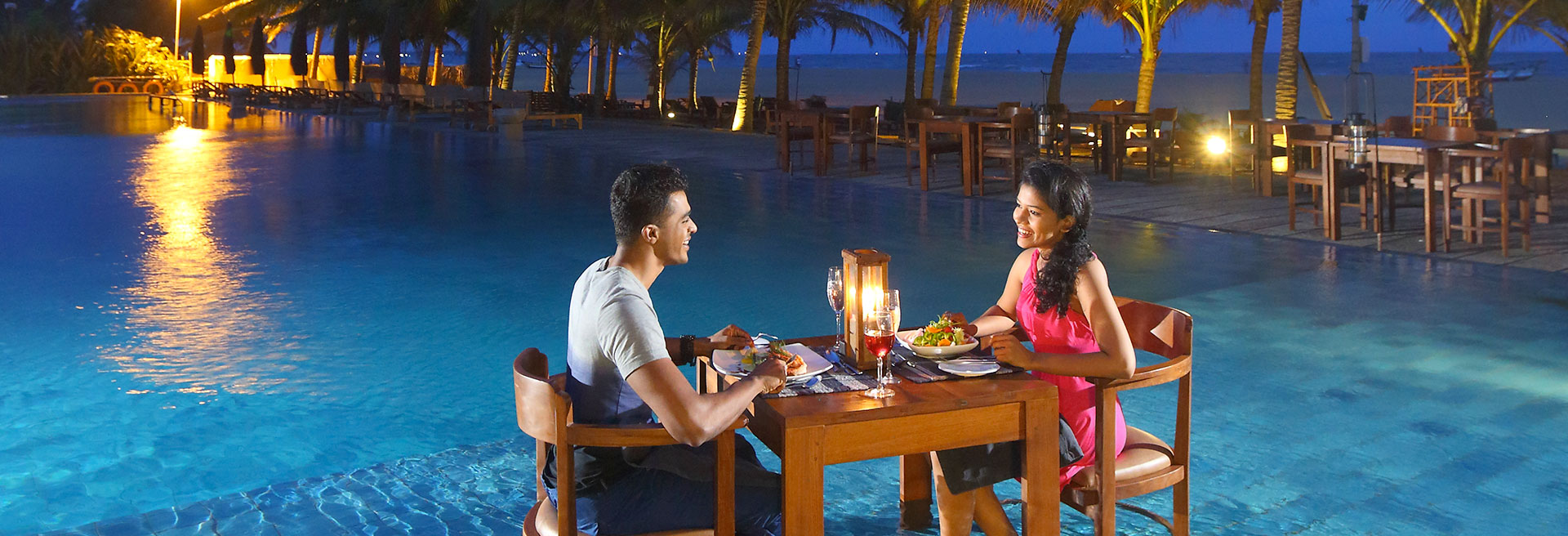 A romantic candlelit dinner by the pool