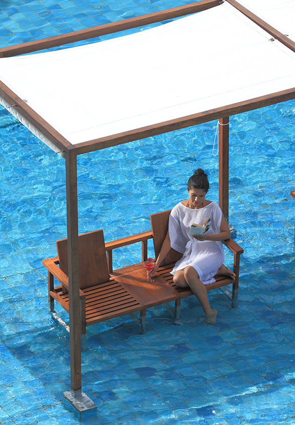 lady sitting on a pool chair