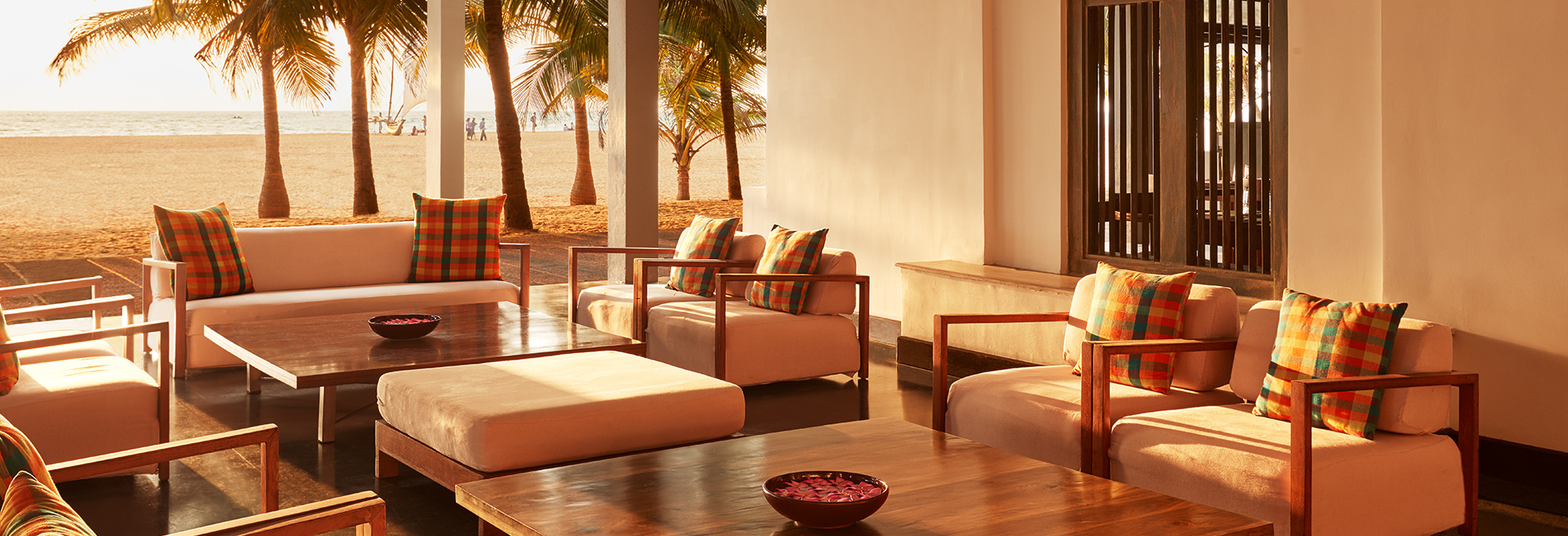 Open lounge area with array of sofas looking into the ocean