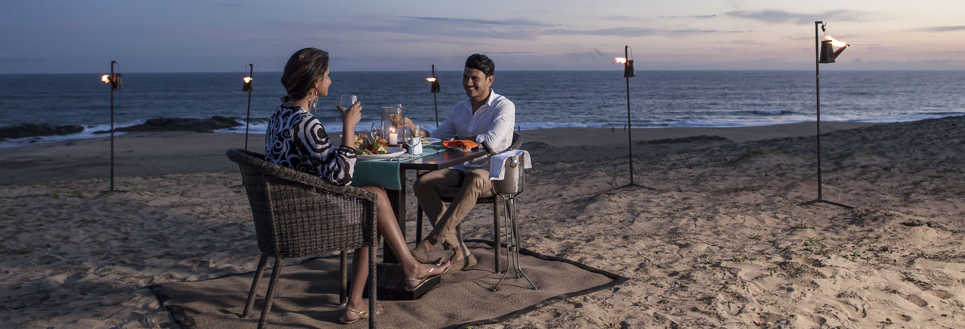couple having a signature dining experience on the beach