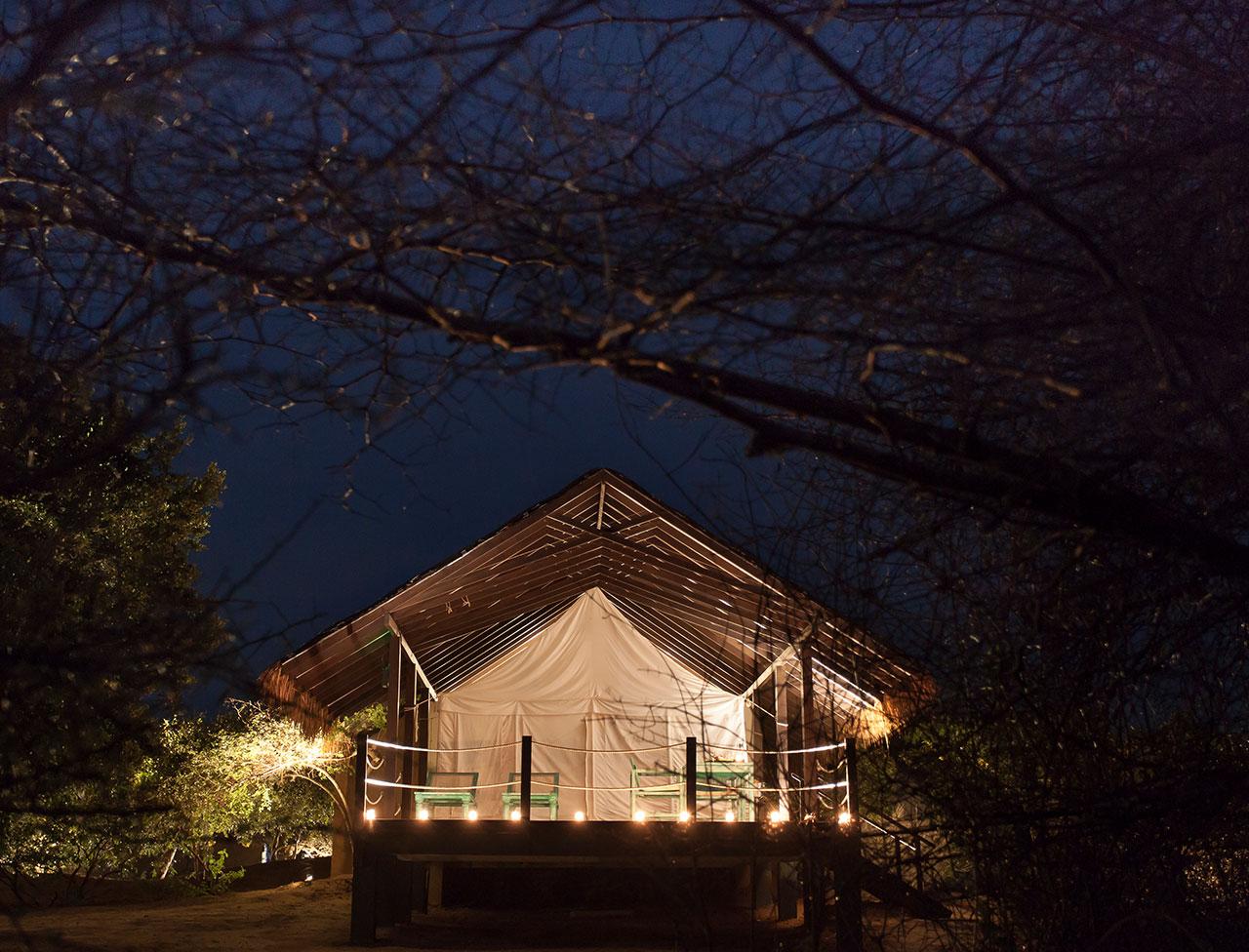 View of a tented villa at night