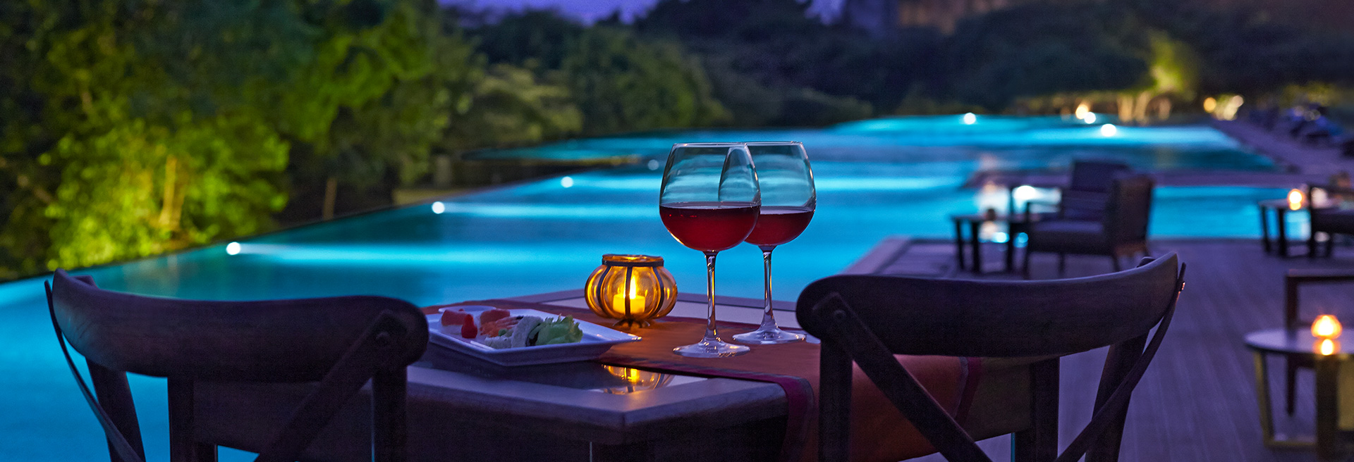 two glasses of wine set out for dining at night