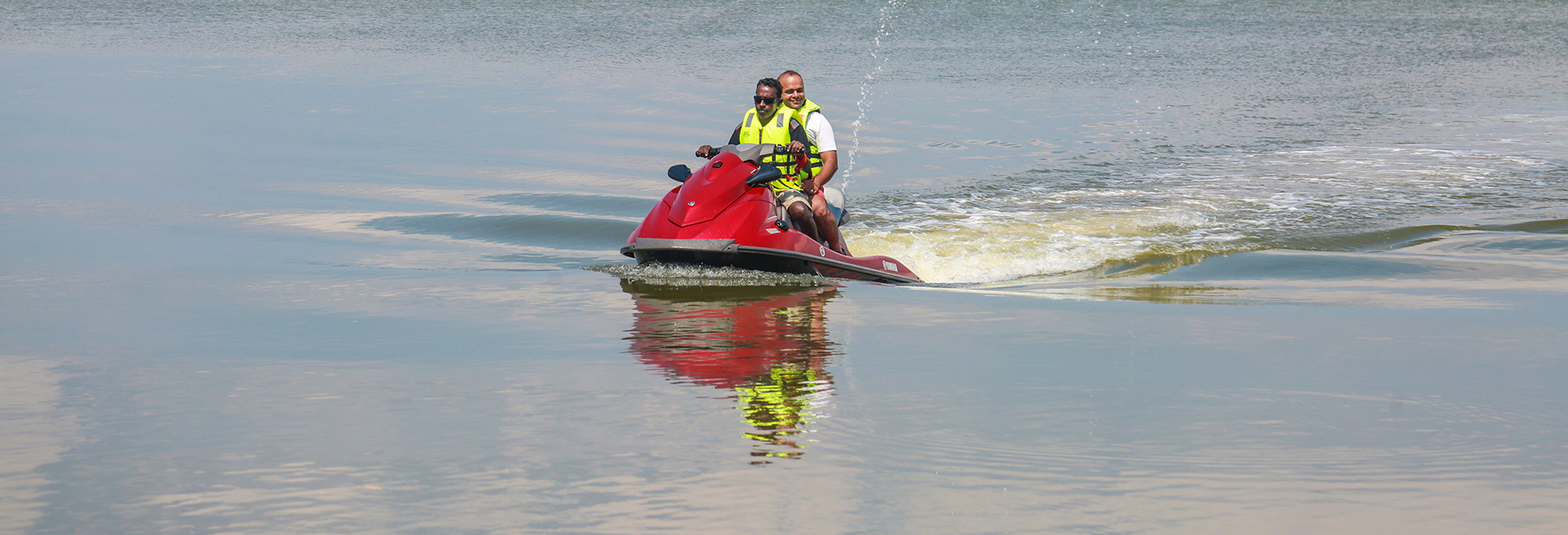 instructor taking a customer on a ride on a Jet Ski