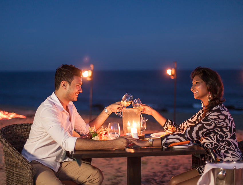 candlelight dinner on the beach at night