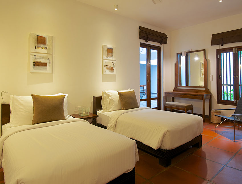 two single beds in one of the rooms