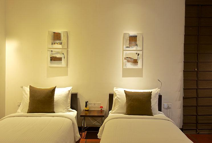 queen size bed in the deluxe room