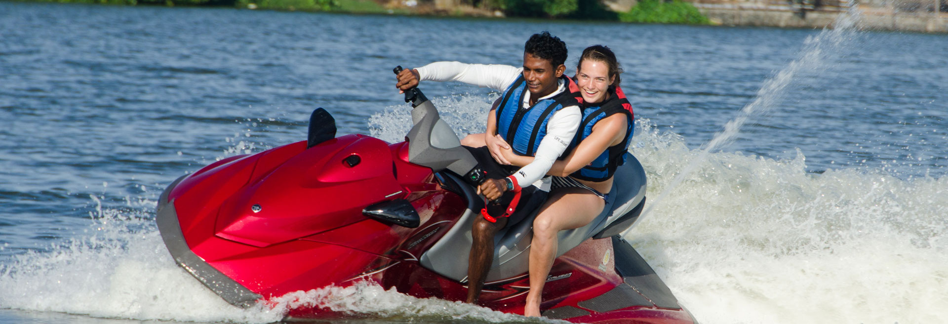 couple jet skiing on the negombo lagoon