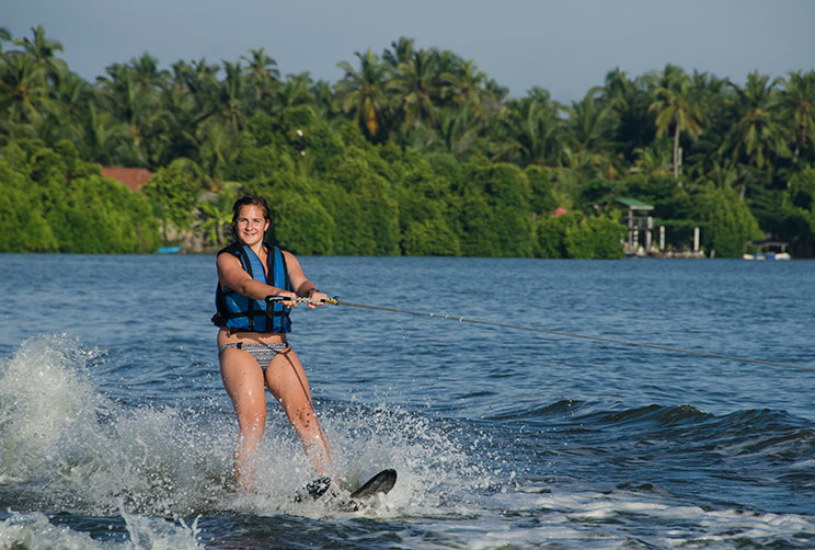 Lady wakeboarding in the lagoon