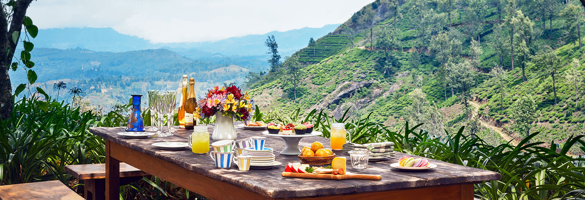 Breakfast set out on with a hillside view