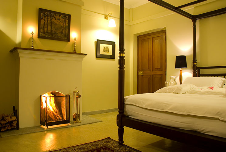 fireplace view alongside the bed