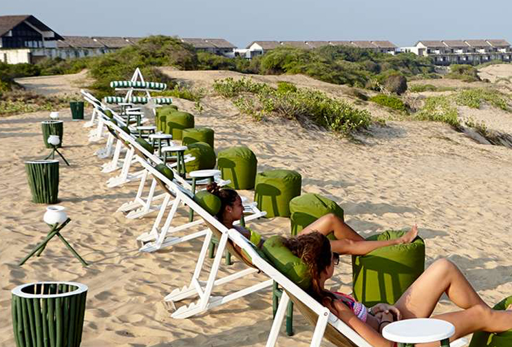 People relaxing on the beach chairs