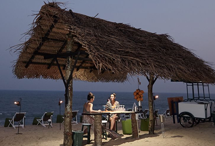 Drinking under the coconut palm trees hut