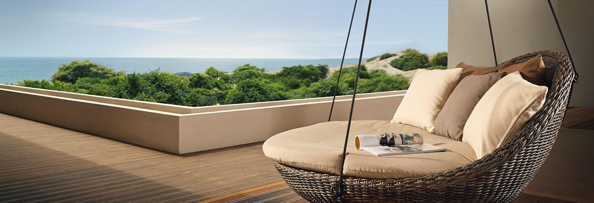 Outdoor hammock chair facing the sea