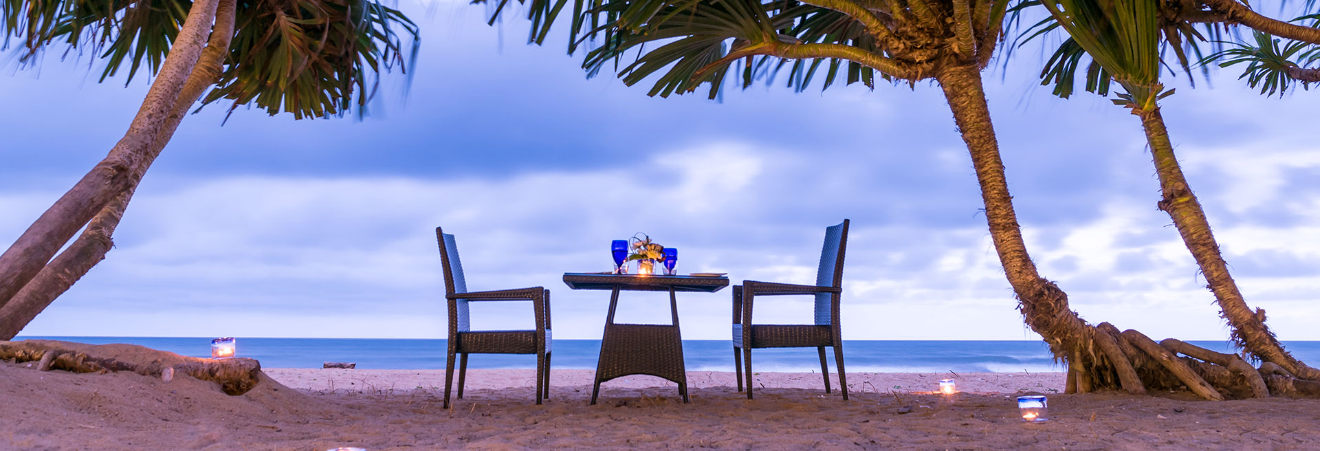 Dining table for two set on the beach