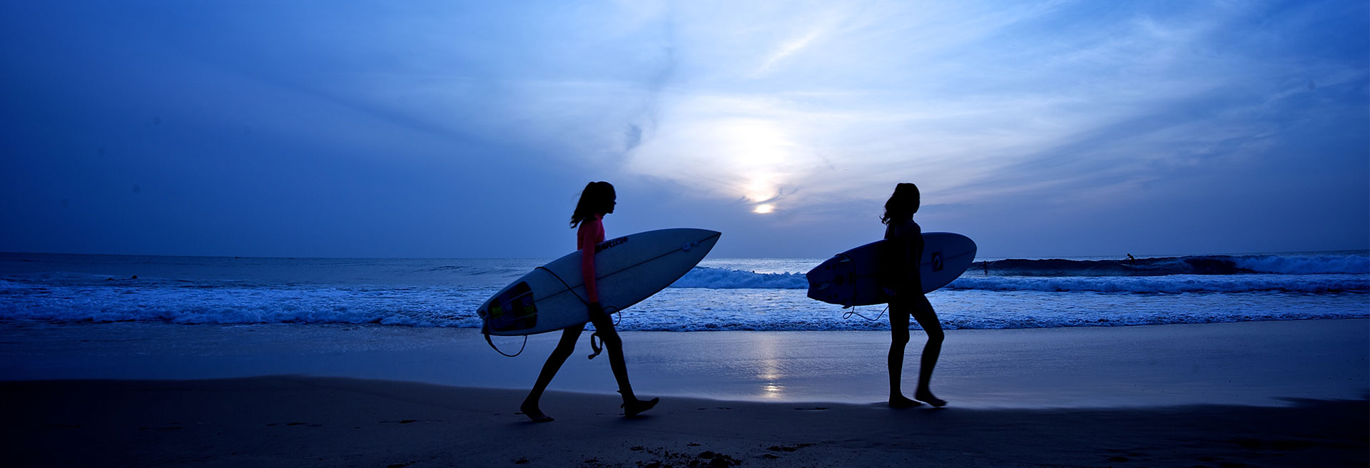 walking on the beach with Surf boards