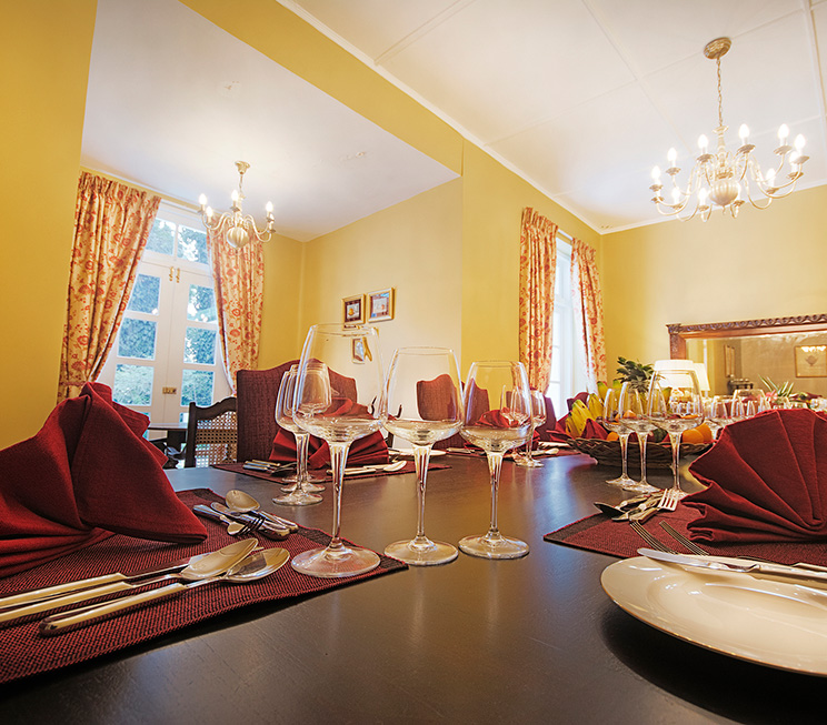Red curtains in the backdrop of the dining area