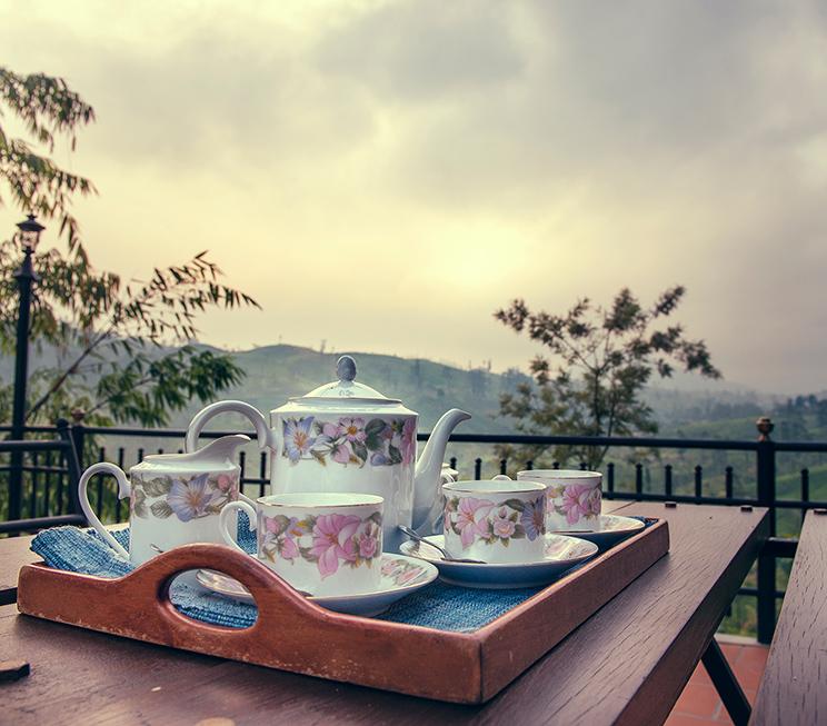 Tea set on the table set outdoors