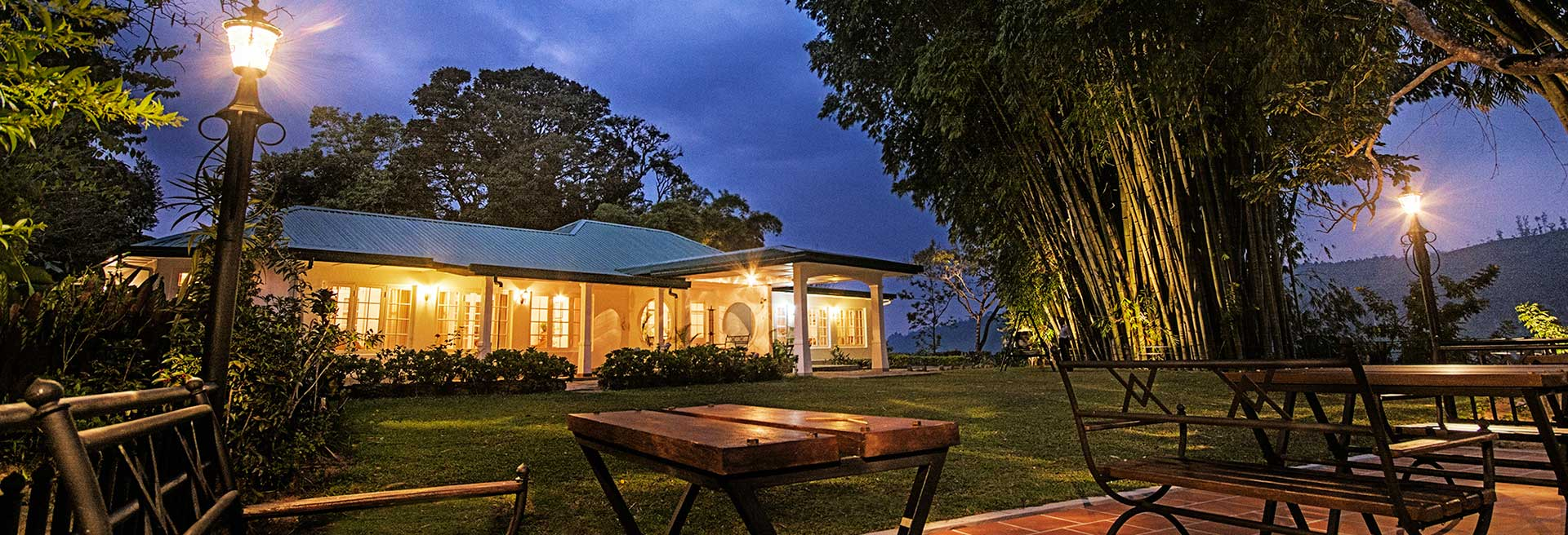 Outdoor dining under the trees at Strathdon by Jetwing