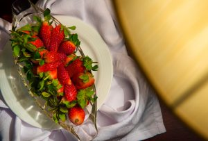 A decedent dish of strawberries