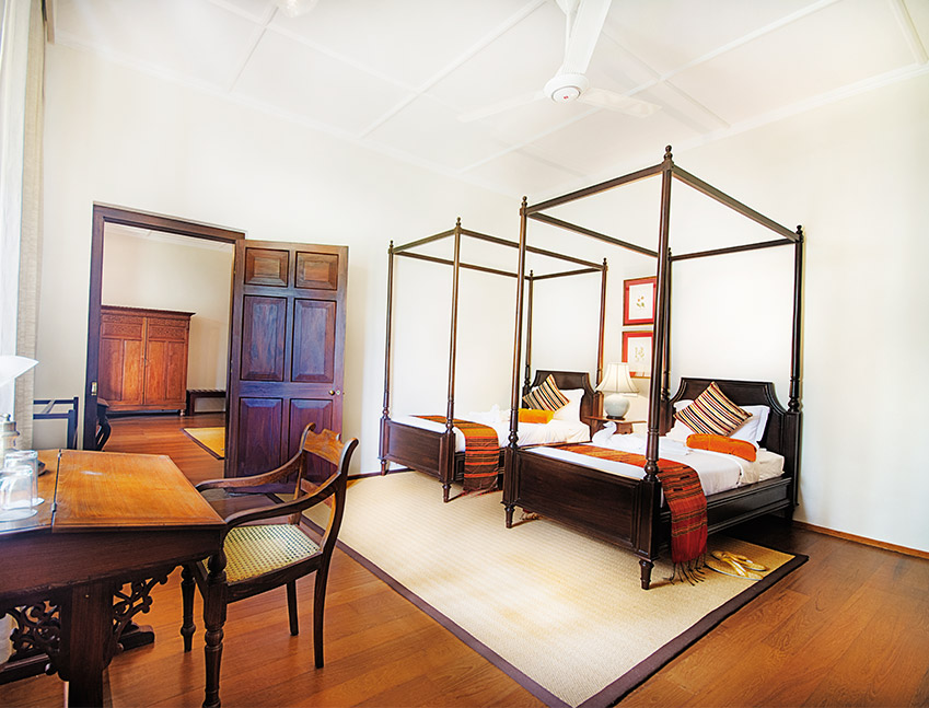 Two curtained four poster beds