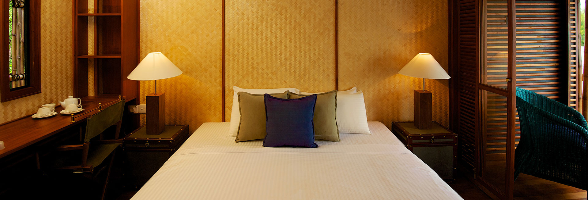 Blue and green pillows on the bed